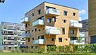 Holzhaus Woodcube: Nachhaltig Wohnen im schadstoffärmsten Mehrfamilienhaus der Welt aus Holz