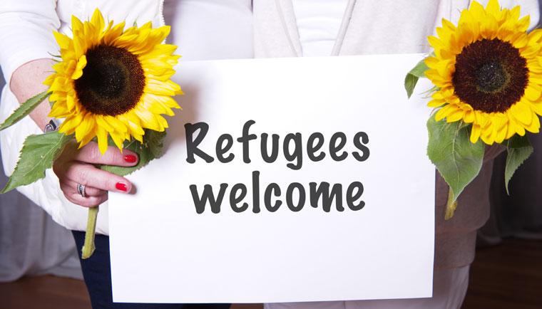 Fluechtlinge werden in Mainz mit offenen Armen empfangen